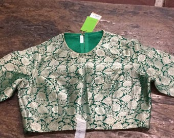 Raw mango green brocade blouse .