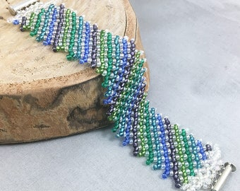 Seed bead net bracelet with green, blue and purple stripes, magnetic slide clasp, beaded jewellery