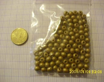 set of 100 gold plated 6 mm wood beads