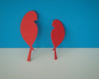 Cut a couple of birds in red paper