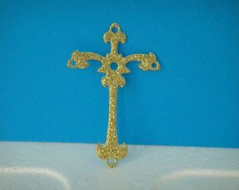 Embossed gold sequined cross cutout