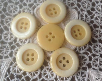 Six buttons in shades of beige