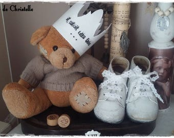 Old pair of leather baby shoes white