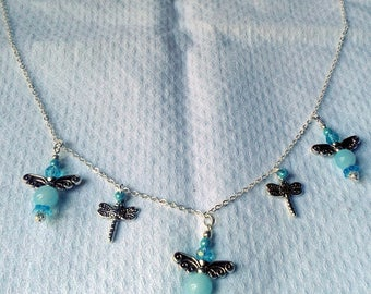The round turquoise dragonflies