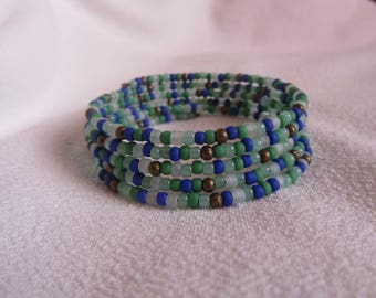 multi-row bracelet cuff seed bead blue hard, bright green, green celadon and blue ice, glass beads and bronze metal