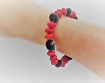 Two-tone elastic bracelet with alternating zanzibar seeds and réglise