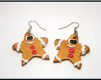 Earrings with gold polymer clay Christmas star.
