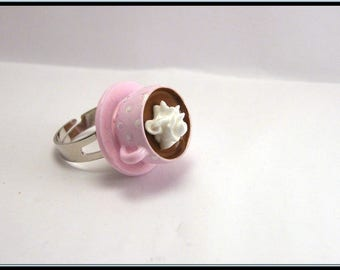 Ring Cup of hot chocolate with whipped cream.