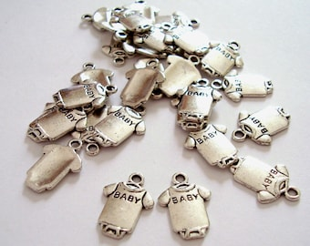 Sold in packs of 10 charms in the shape of body