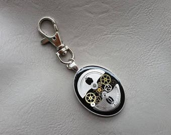 Oval metal pendant, resin and watch parts jewelry