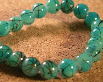 glass 6 mm turquoise speckled black - PE97 trefilee 20 beads