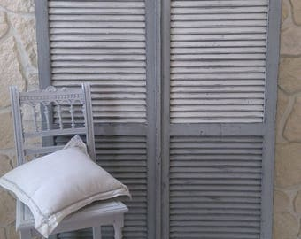 2 wooden shutters weathered old