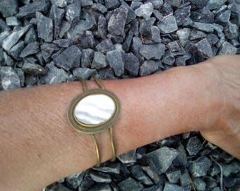 Norman Pearl on bronze bracelet