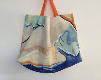 Handpainted beige oversize Beach Tote as a table