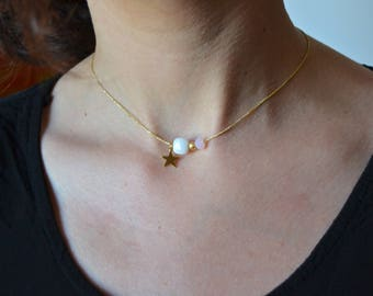 Gold plated star and white stone necklace