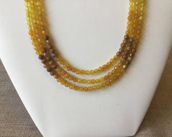 Necklace 3 rows of yellow and Brown agates.