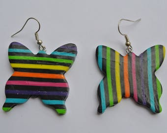 a pair of inverted rainbow earrings