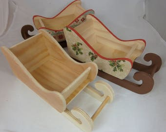 Small raw wooden sled has decorate