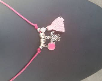 The Choker necklace with tassel and charms