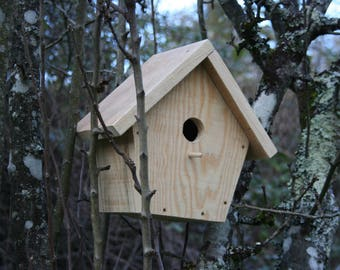 Pine wood birdhouse