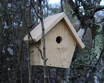 Pine wood birdhouse