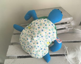 Plush turtle shell removable thanks to its pressures.