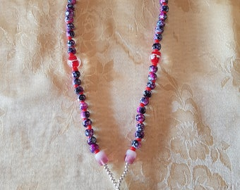 handcrafted beaded necklace pink and red.