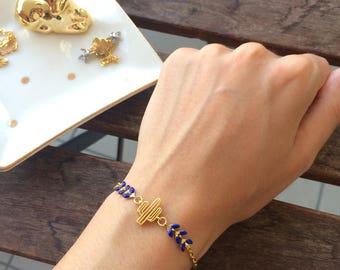 Bracelet gold cactus and dark blue ear chain