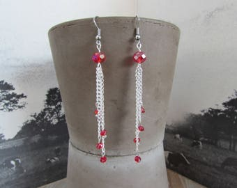 Long dangle earrings with bright red crystals