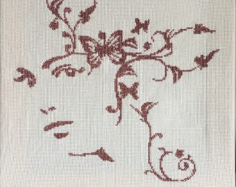 Face woman embroidered cross stitch canvas