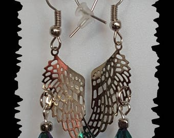 "Earrings ""wings"" filigree and blue faceted drops"