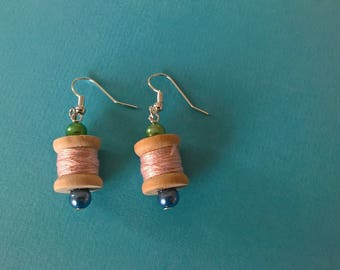 Earrings shaped spool of thread