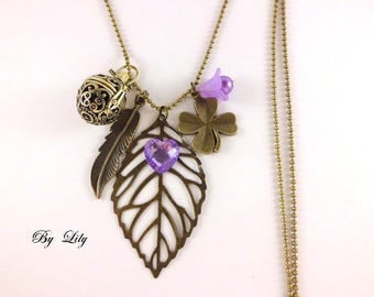 Long perfume, leaf filigree and purple Rhinestone Heart!