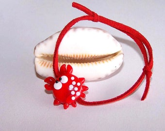 Adjustable bracelet with red suede and red crab