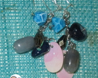 Pair of earrings with many shades of blue/gray beads