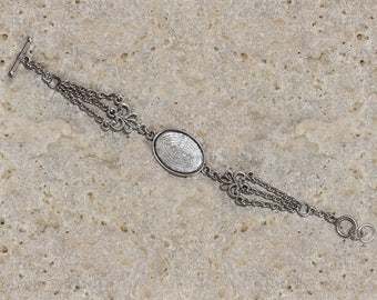 Support oval cabochon 25 X 18 mm silver tone bracelet