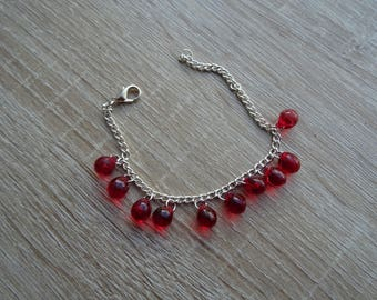 Red bracelet with chain and beads