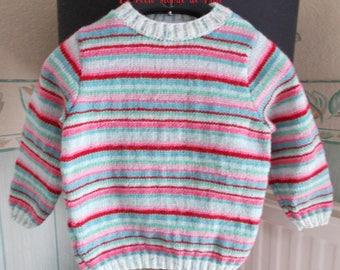 girl pastel striped sweater