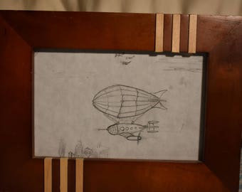 Steampunk zeppelin blimp in pencil air ship
