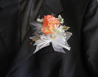Orange and white groom's boutonniere