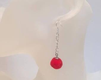 Round red tassel earrings