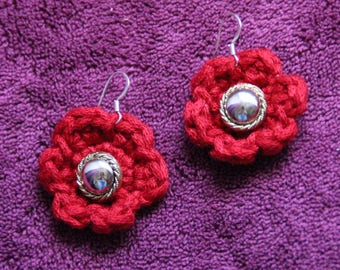 Center button and crocheted red flower earrings