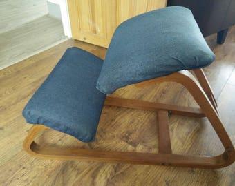 Vintage kneeling chair in need of restoration