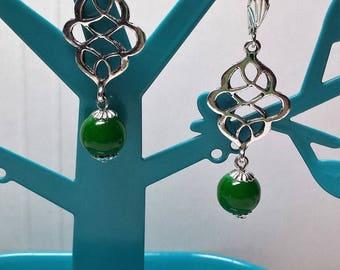 Beautiful green jade beads and twisted diamond earrings