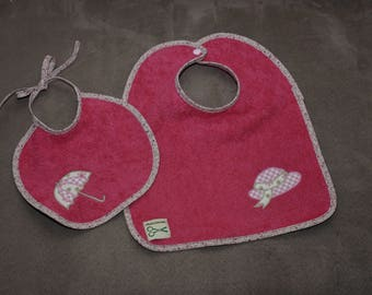 Set of two hot pink baby bibs, hat and umbrella