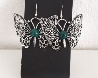 Butterfly and green cabochon earrings