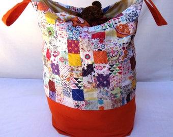 Bag toys, orange and multicolored patchwork storage basket
