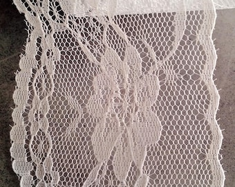 White lace by the yard with floral motifs