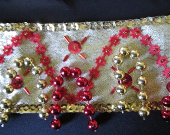 10 - Up arm bracelets and cuffs in gold lame cotton.