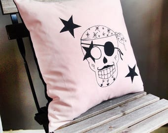 Square cushion in pale pink and black skull